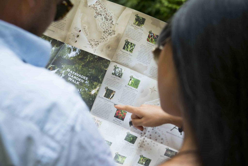 Guests enjoying a self-guided tour through the gardens with our Rayavadee Garden Map.